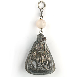 Antique Chinese Qing dynasty hollow repoussé silver hat amulet depicting Chinese mythological Taoist Deity with agate bead. pdvs672