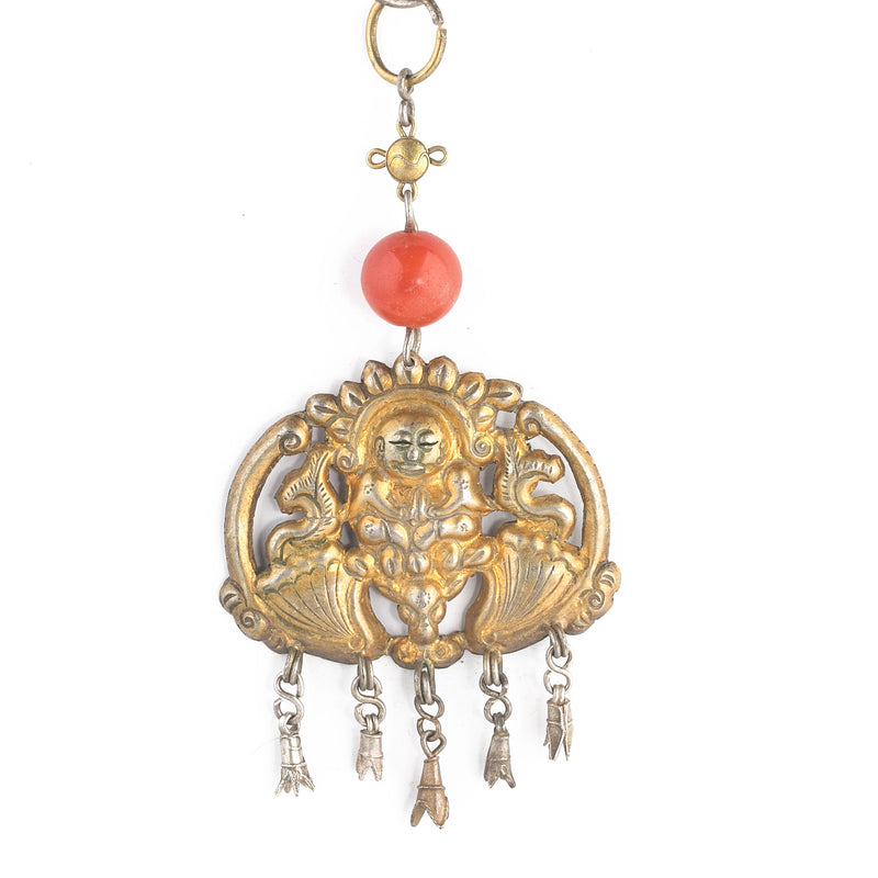 Antique Qing dynasty gilded coin-silver pendant. Depicts a sitting Buddha atop a bat. carnelian bead and ring. pdvs906