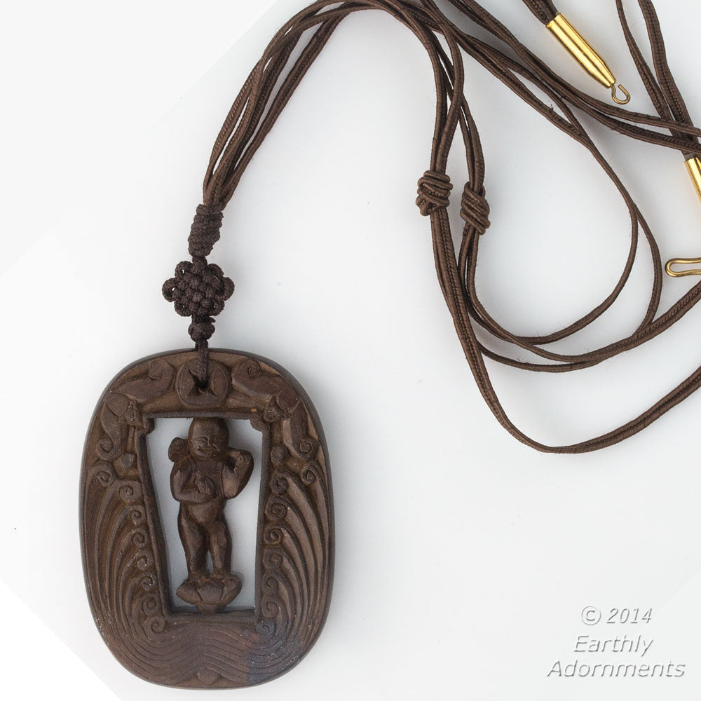 Vintage Chinese carved wood swiveling deity with two bats descending from heaven pendant. pdwd101