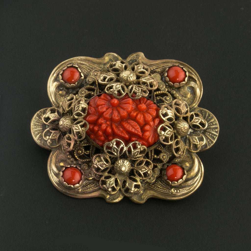 Vintage Czech Bohemia brass filigree brooch with red molded glass stone. pnbg1011