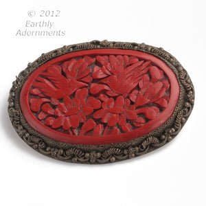 pnor653(e)- Vintage Chinese cinnabar brooch signed China set in ornate silver frame.