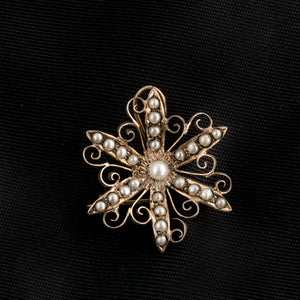 Antique Victorian sterling silver goldwash vermeil seed pearl starburst pin. pnvc1086