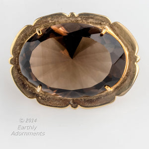 Gold filled over sterling setting with large smoky quartz stone. Omega pin combination. 1.6 x 1.2 inches. pnfn106e