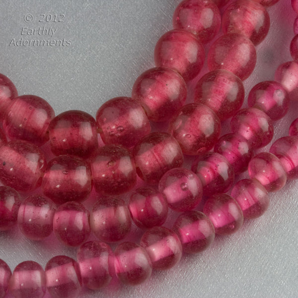 Chinese Peking glass beads in a translucent dark rose, 8mm.