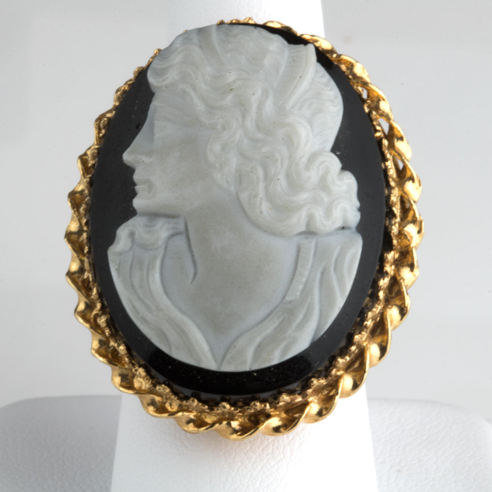 Cameo carved from single bulls eye agate stone set in 14k gold ring setting Size 7. Rgvn180