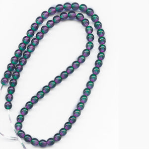 Contemporary Czech emerald and violet glass 6mm rounds, strand of @75. b11-gr-1169(e)
