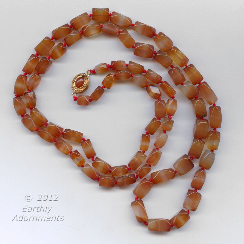 Vintage necklace of faceted natural carnelian banded agate, knotted with sterling silver vermeil clasp with carnelian stone. nlbd1067