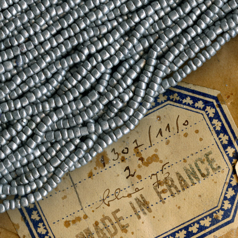 b17-105-Antique French matte aluminum glass seed bead Size 10 . 50 gram bag