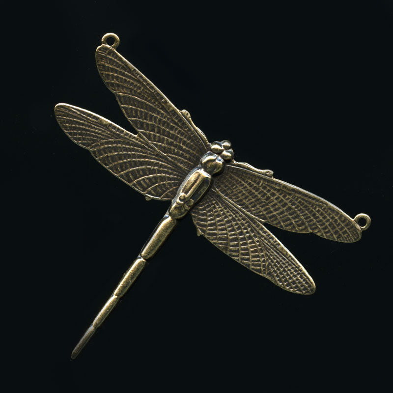 Oxidized solid brass Dragonfly Stamping. A ring at the end of each wing. 50mm wingspan, 40mm long. Sold individually. b9-0522A(e)