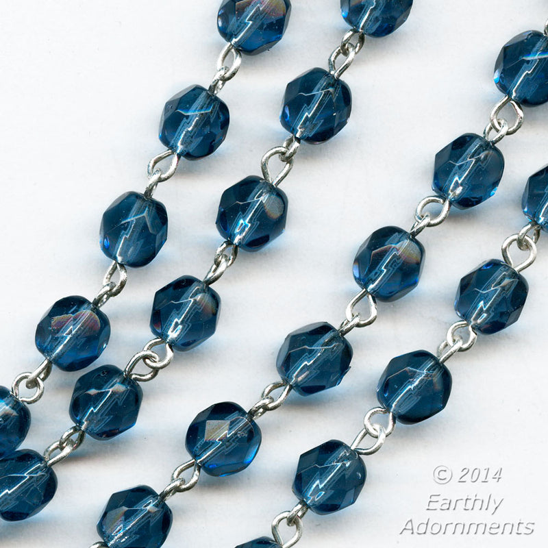 "Czech chain of Montana blue faceted glass beads and silver wire. 6mm faceted rounds. Sold in 36"" lengths. b12-chn684(e)"