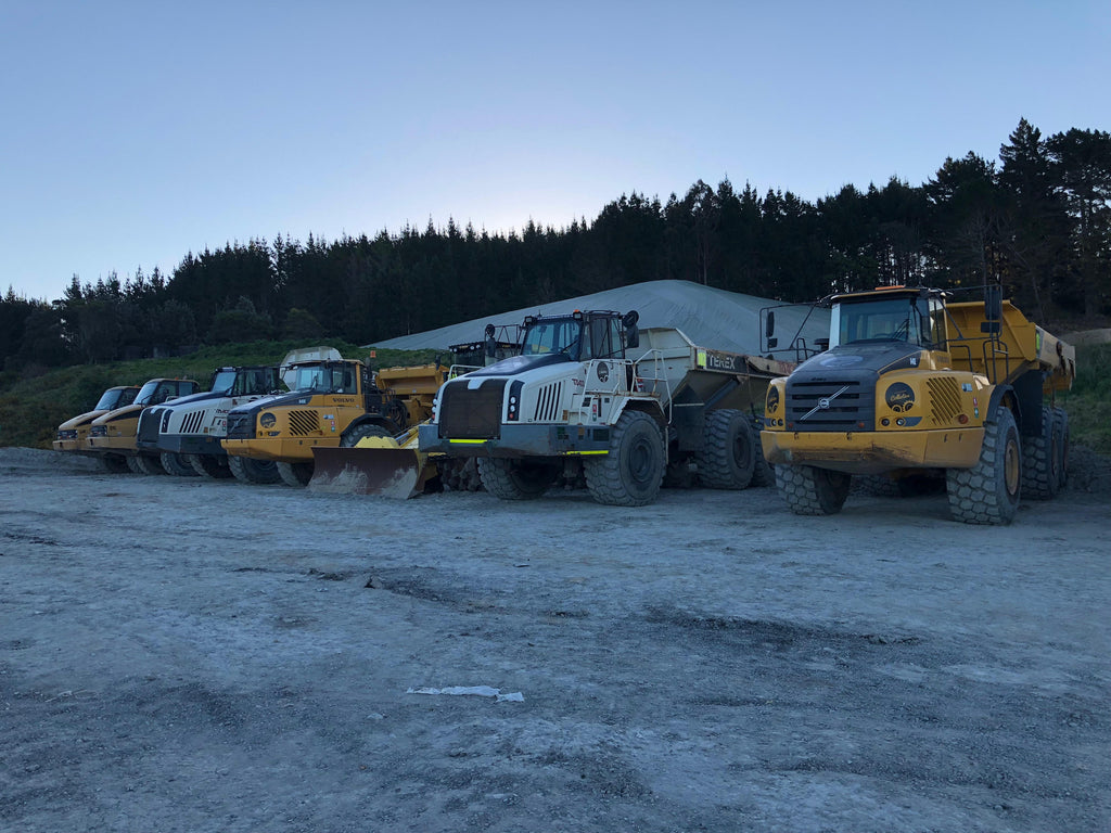Articulated dump trucks lined up