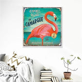 vintage pink flamingo hanging on the wall