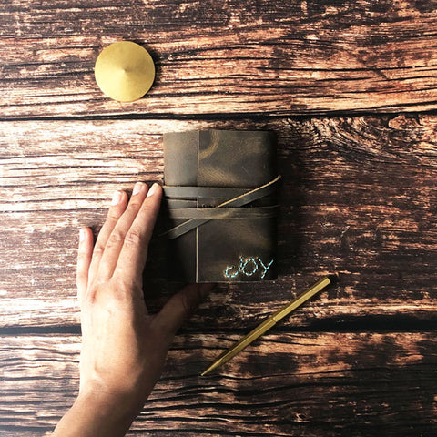 Small leather journal with handstitched Joy