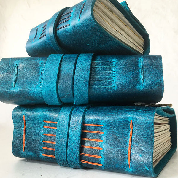 Rustic ocean blue leather journal stack