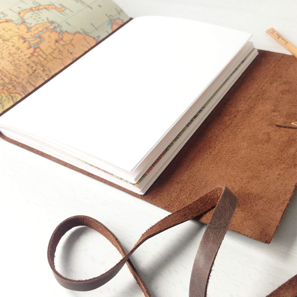 Brown leather travel diary open pages view