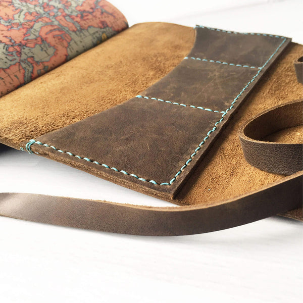 Open book view of  saddle stitched travelers notebook with card slots