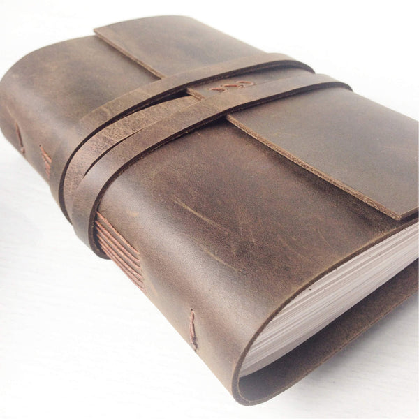 A6 brown leather bound notebook side angle view