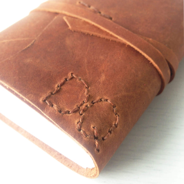 A7 pocket journal with custom monogram, tan leather