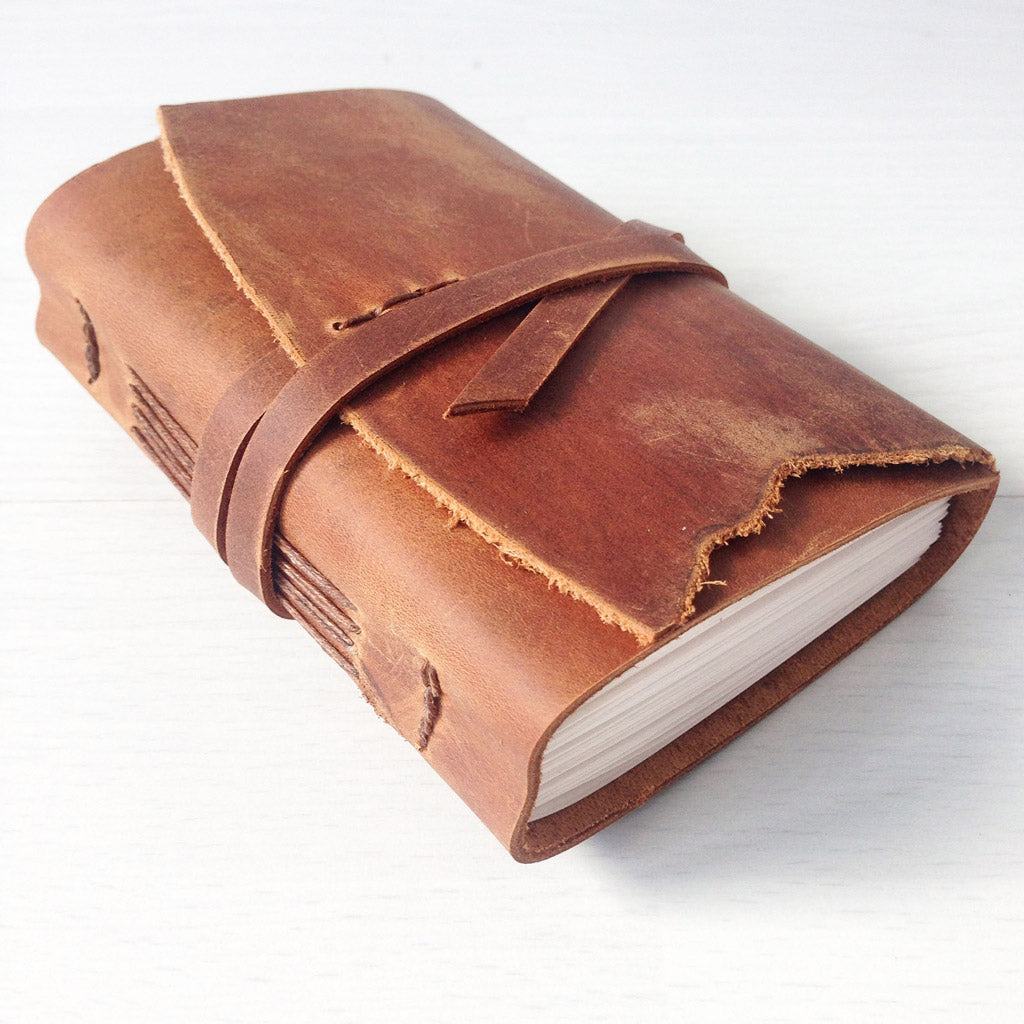 A7 tan leather small notebook side view