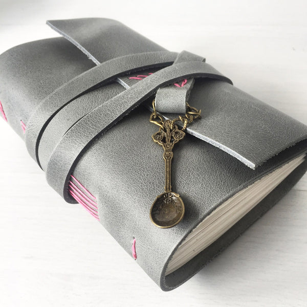 Blank recipe book grey leather with spoon charm, side view