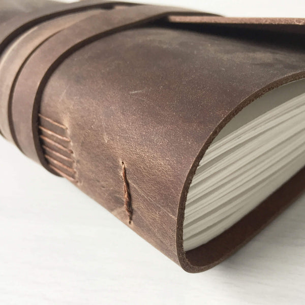 Brown leather journal side view
