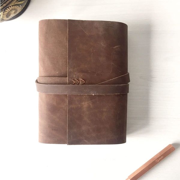 Brown leather journal front aerial view