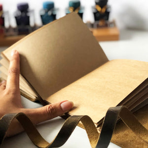 Leather journal, brown Kraft paper pages, open