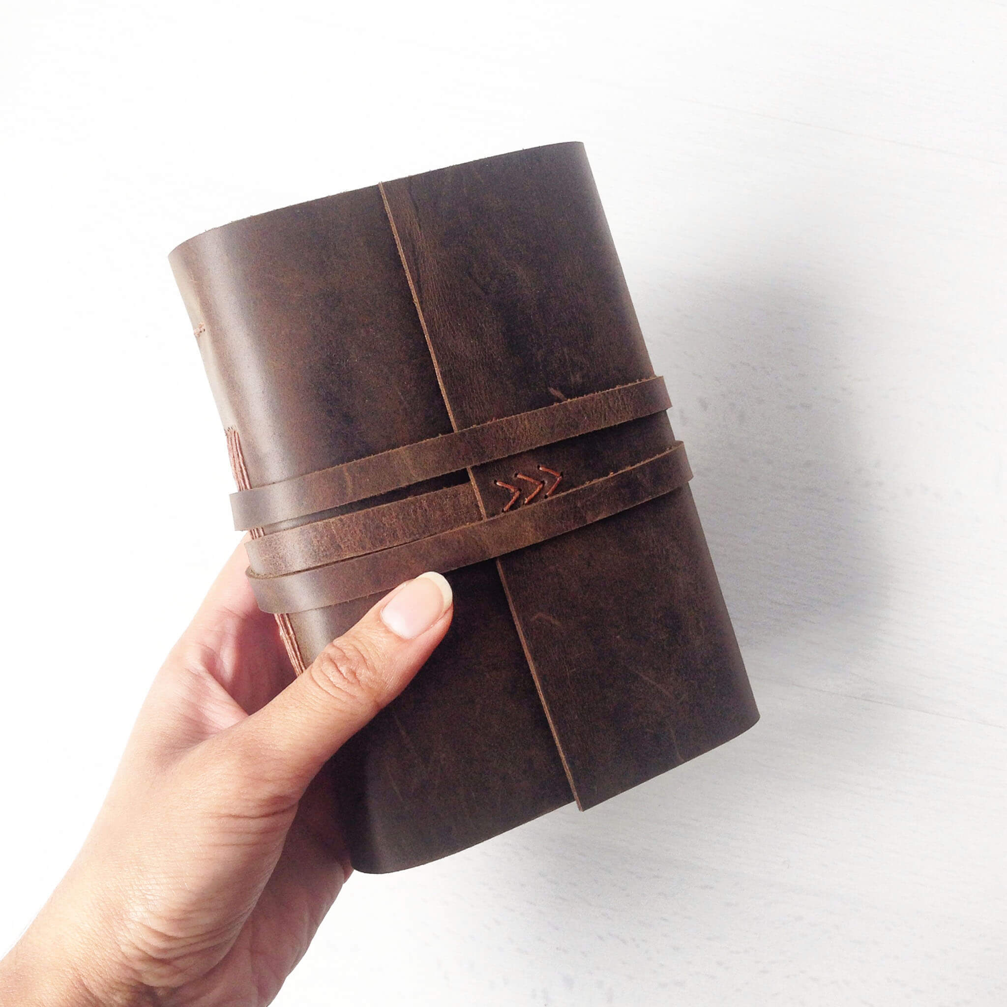A6 custom sketchbook brown leather, front view