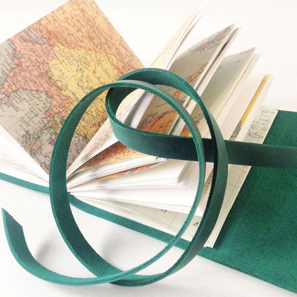 A6 vintage world map pages travel journal open book view