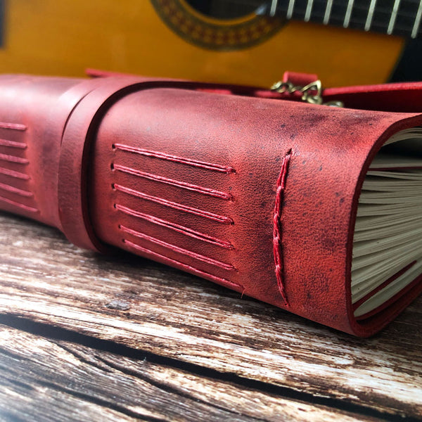 leather music composition book side view