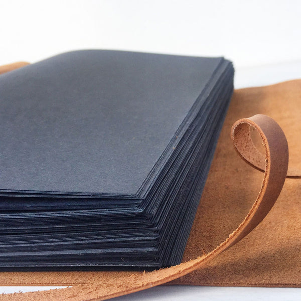 Leather journal with black paper pages