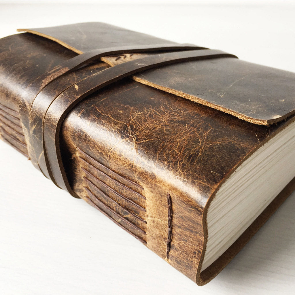 Large rustic brown leather sketchbook side view
