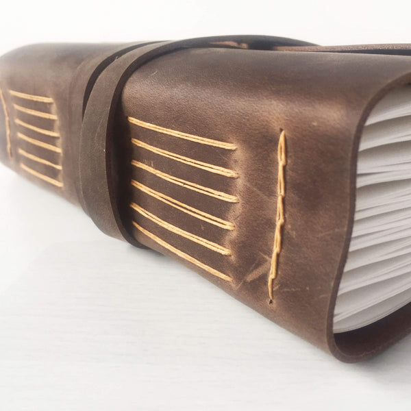 Leather bound notebook, brown/butterscotch side view