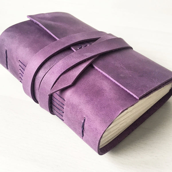 Purple leather bound book side view