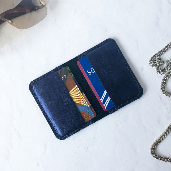 Metallic blue leather card wallet open