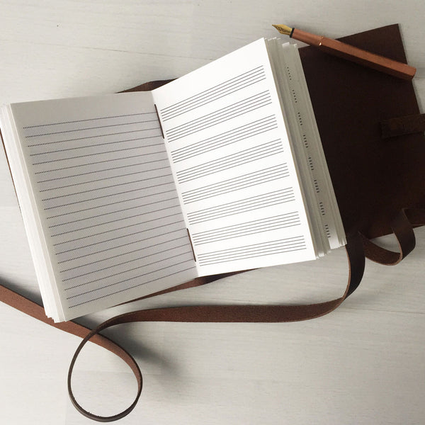 Leather music journal with blank sheet music pages