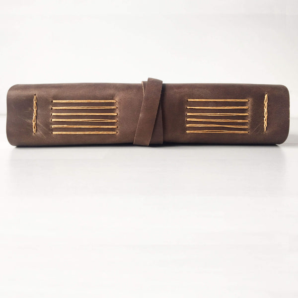 Leather notebook side view, brown leather butterscotch stitching