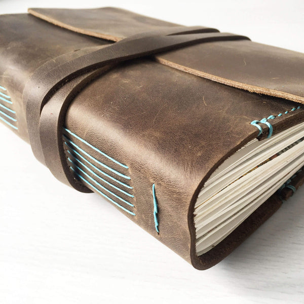 A5 brown leather with turquoise stitching side longstitch binding view