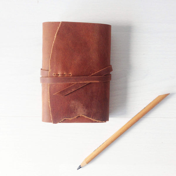 Tan leather pocket journal, A7, front view