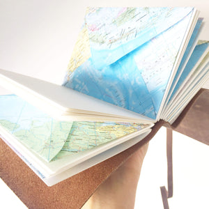 Inside view of leather travel journal with map envelope pages