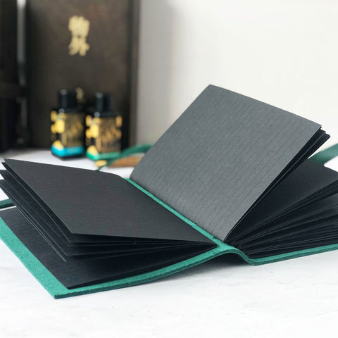Leather journal with lined black pages