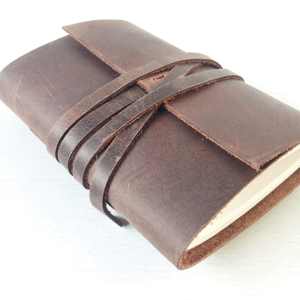 A7 brown leather mini notebook side angle view