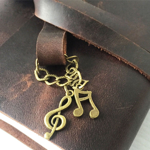 Musical notes charms notebook close up