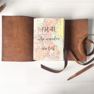 Not All Who Wander Are Lost Quote Printed On A Map Journal