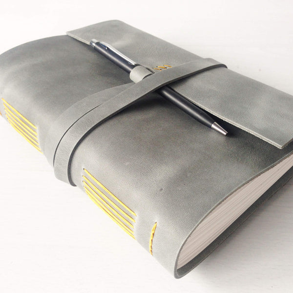 A5 grey personalized leather notebook with pen loop, yellow stitching