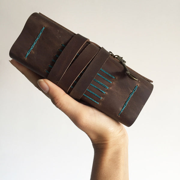 A6 brown leather recipe book side view, brown with teal stitching