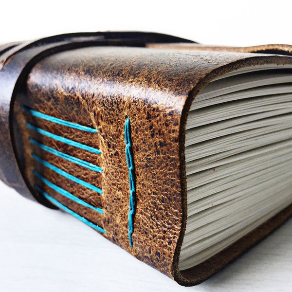 Rustic brown leather teal stitching