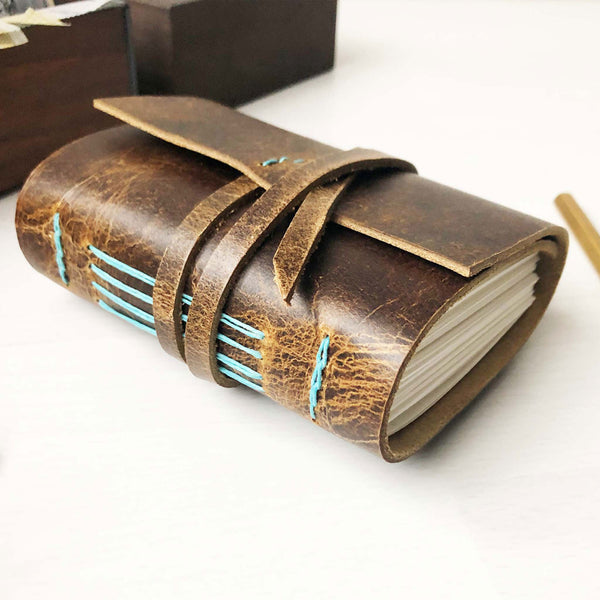 Small leather notebook side view