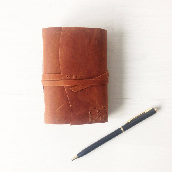 Small sketchbook in tan leather, front view