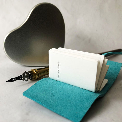 Gratitude journal with heart gift box